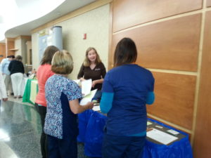 Maria Answers Questions About TOFI's Local Meats at the Witham Hospital Employee Health And Wellness Fair on May 18